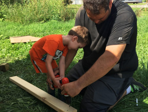 Myles helping Daddy build