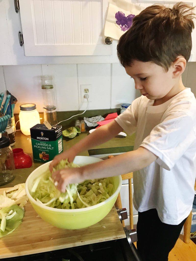 Myles mixing up the shredded cabbage and salt